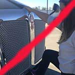 Do not lift the hood from the front of the CMV